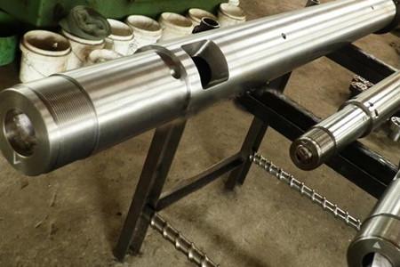 延长锥形双螺杆挤出机螺杆机筒使用寿命的方法